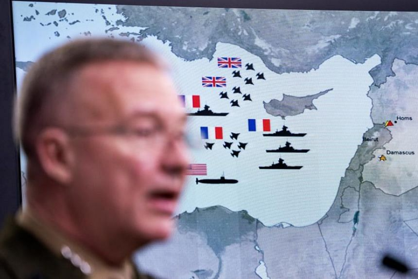 A damage assessment graphic appears behind Joint Staff director Marine Lt. Gen. Kenneth F. McKenzie Jr. as he speaks to the media about the US-led bombing campaign against Syria inside the Pentagon briefing room in Arlington, Virginia, US on April 14