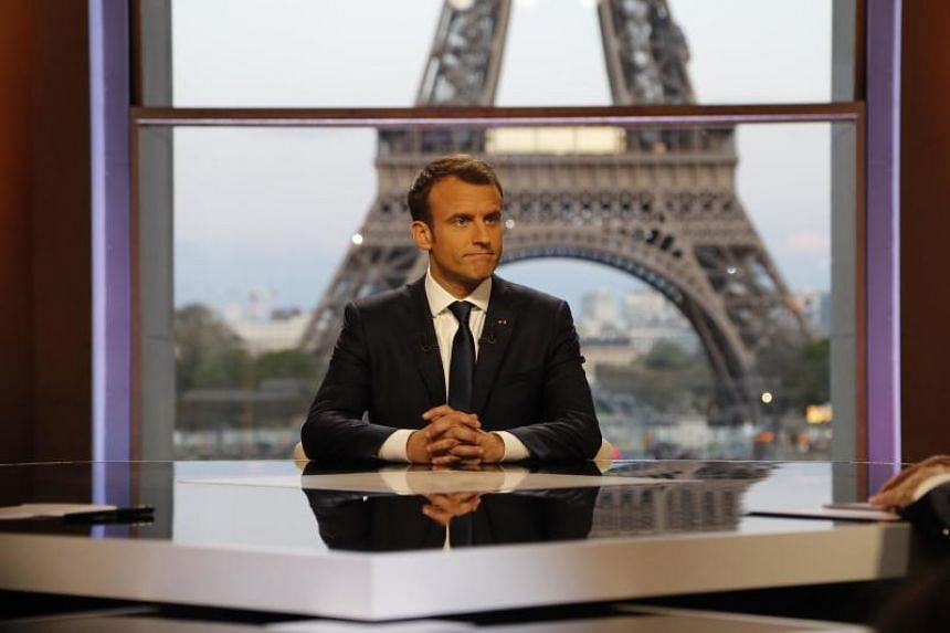 French President Emmanuel Macron poses on the TV set before an interview with RMC-BFM and Mediapart French journalists at the Theatre National de Chaillot in Paris, France, April 15, 2018.
