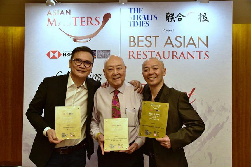 Gold winners of The Straits Times and Lianhe Zaobao's Best Asian Restaurants Awards (from left) Summer Pavilion Chinese executive chef Cheung Siu Kong, Imperial Treasure Fine Teochew Cuisine's group operation manager Jimmy Leung and Shinji by Kanesak