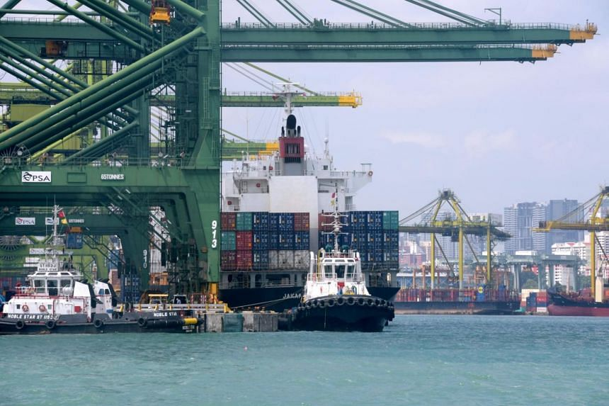 File photo showing a port and container ships in Singapore on Dec 20, 2017.