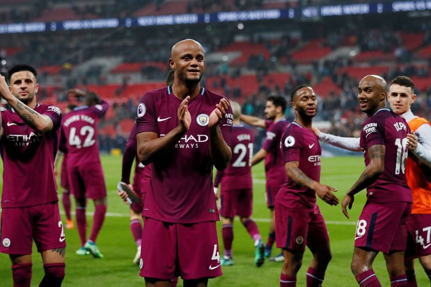 Manchester City's Vincent Kompany and teammates applaud the fans after the match, on April 16, 2018.