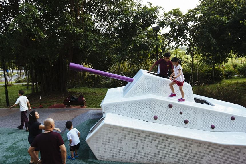 Children playing at an army-themed playground in Choa Chu Kang.