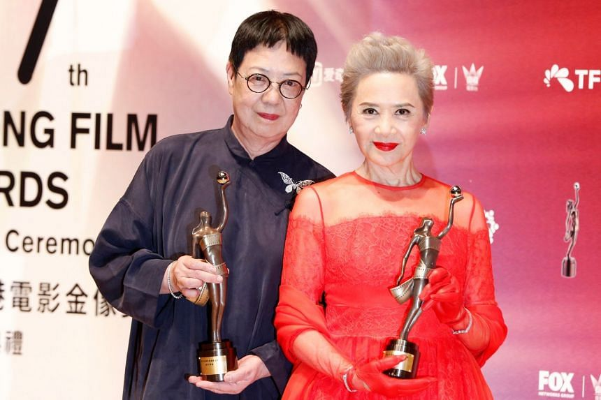 Hong Kong director Ann Hui (left) and actress Deanie Ip posing with their Best Director and Best Supporting Actress awards.