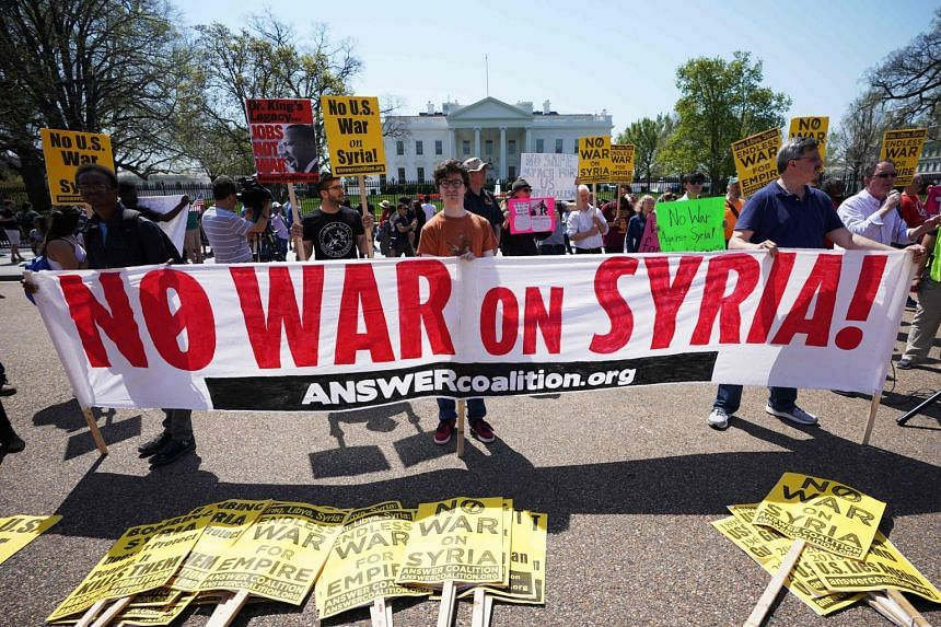 Demonstrators protesting against the US-led strikes on Syria in front of the White House in Washington on Saturday. The bombings struck at the heart of Syria's chemical weapons programme in retaliation for a suspected poison gas attack on April 7.