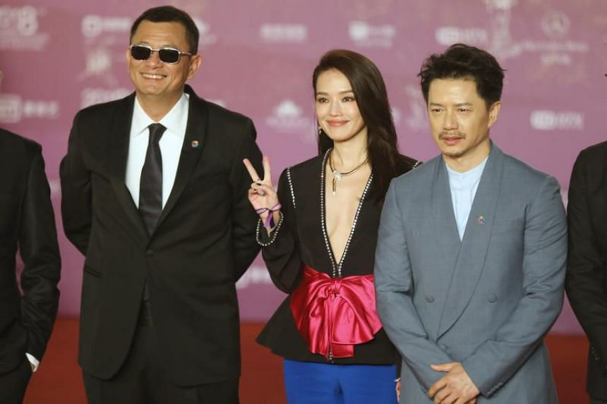 From left: International jury members of Tiantan Award, Hong Kong director Wong Kar Wai, Taiwanese actress Shu Qi, Chinese actor Duan Yihong arrive on the red carpet at the 8th Beijing International Film Festival on April 15, 2018.