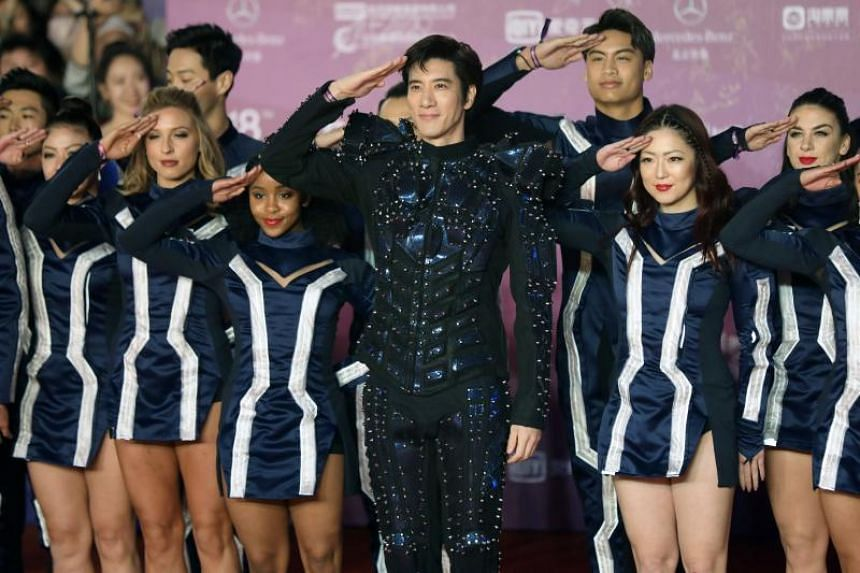 Chinese actor Wang Leehom poses on the red carpet at the 8th Beijing International Film Festival on April 15, 2018.