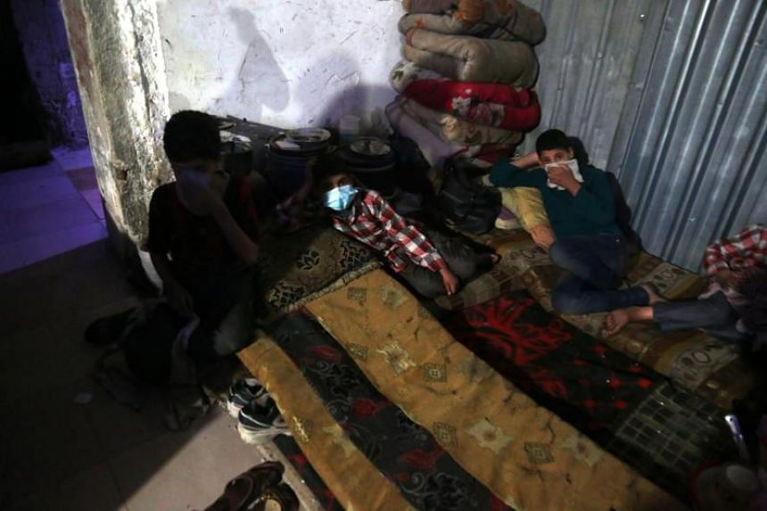 Injured victims of an alleged chemical attack rest in rebels-held Douma, Syria, on April 8, 2018.