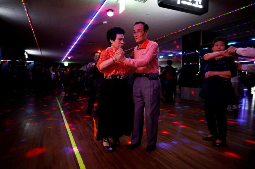 Han Min Ja and Yang Won Ju dancing at a daytime disco for the elderly in New Hyundai Core located in Seoul, South Korea on April 10, 2018.