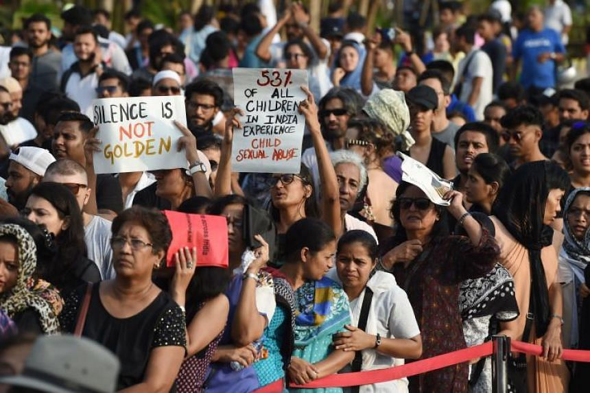 Indian demonstrators hold placards during a protest in support of rape victims following high profile cases in Jammu and Kashmir and Uttar Pradesh states, in Mumbai on April 15, 2018.