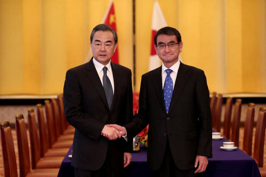 Chinese Foreign Minister Wang Yi with his Japanese counterpart Taro Kono in Tokyo on April 15, 2018.
