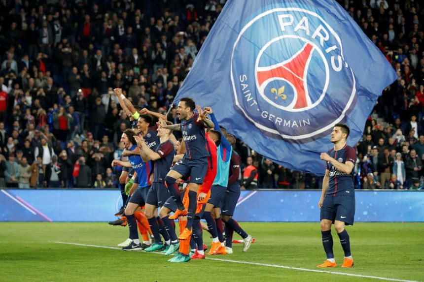 Paris Saint-Germain players celebrate winning Ligue 1 after beating Monaco 7-1 on April 15, 2018.