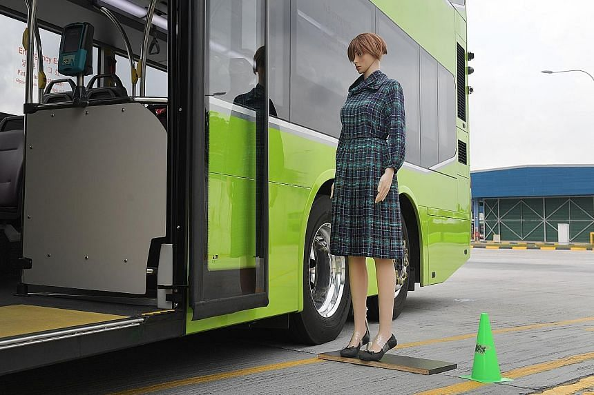 A mannequin being used to demonstrate the effectiveness of the side-mounted sensors, which can be seen near the rear of the bus. There are also ultrasonic sensors on the roof to warn drivers if they are about to hit an overhead obstacle.