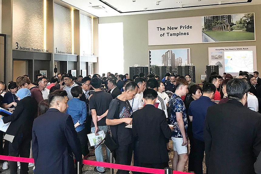 Potential buyers at the launch of Grandeur Park Residences. It was the second top-selling project last month, with 40 units sold. Crowds at The Tapestry's showroom last month. City Developments moved 329 units at the Tampines project last month at a