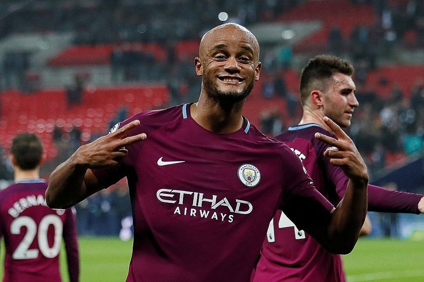 Manchester City captain Vincent Kompany celebrating with the crowd after the 3-1 Premier League win over Tottenham on Saturday.