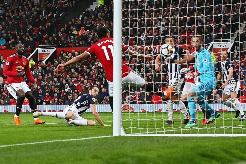 West Brom's Jay Rodriguez (on ground) scoring the goal that beat Manchester United 1-0 in the Premier League on Sunday. United's defeat also meant that Manchester City clinched the league title with five games left to play.