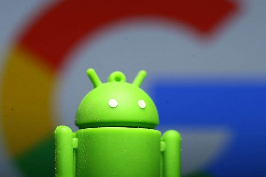 A 3D-printed Android mascot seen in front of a Google logo in an illustration photo taken on July 9, 2017.