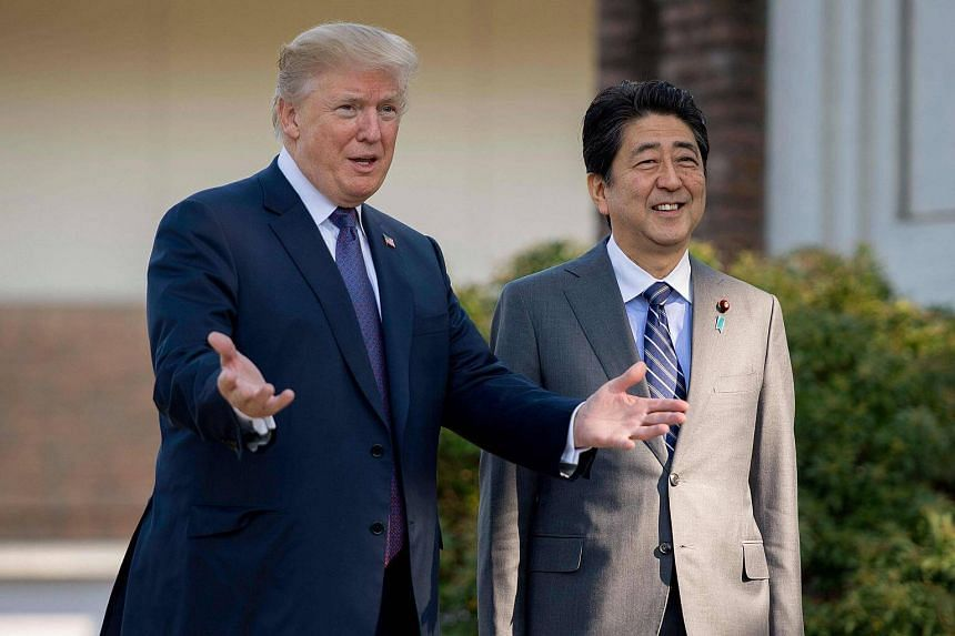 United States President Donald Trump (left) will welcome Japanese Prime Minister Shinzo Abe today at Mar-a-Lago resort in Florida for two days of talks.