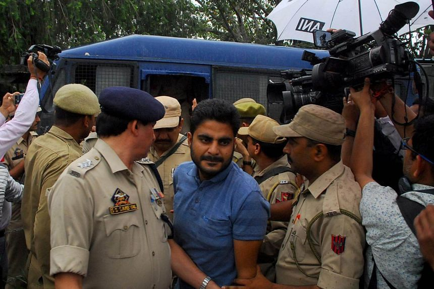 Deepak Khajuria arrives for a court appearance on April 16, 2018, after he was arrested in connection with the rape and murder of an eight-year-old girl in Kathua, south of Jammu, India.