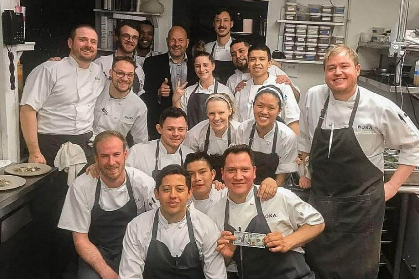 The restaurant posted an Instagram photo of the man giving a thumbs-up sign while posing with smiling kitchen staff.