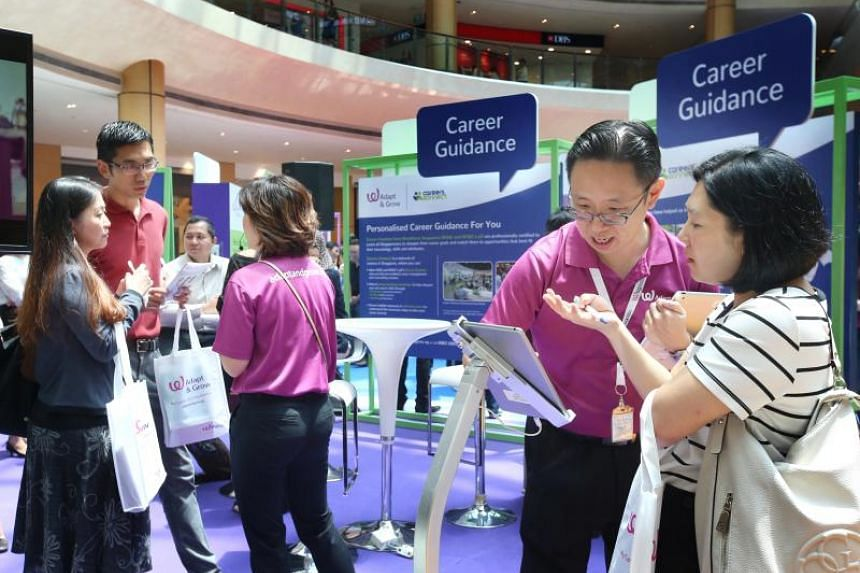 Career coaches (in purple) guide job seekers on how to navigate MyCareersFuture.sg, a portal which aims to help jobseekers find jobs using data.