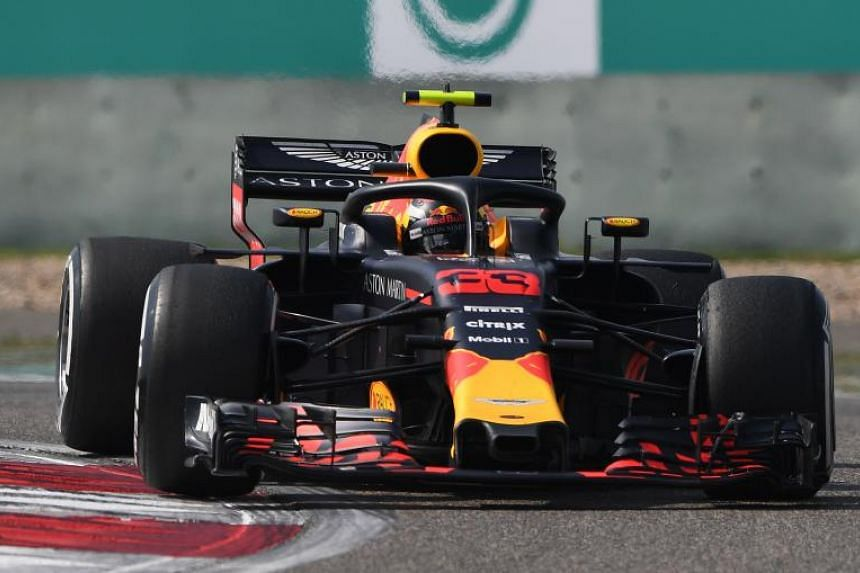 Red Bull's Dutch driver Max Verstappen takes a corner during the Formula One Chinese Grand Prix in Shanghai on April 15, 2018.
