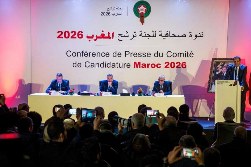 (From left) Fouzi Lekjaa, President of the Royal Moroccan Football Federation (FRMF), Moulay Hafid Elalamy, chairman of the Moroccan Committee bidding for the 2026 World Cup, and Moroccan Youth and Sport Minister Rachid Talbi Alami give a press confe