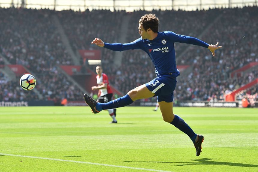 Chelsea's Marcos Alonso plays the ball during the English Premier League football match against Southampton St Mary's Stadium in Southampton on April 14, 2018.