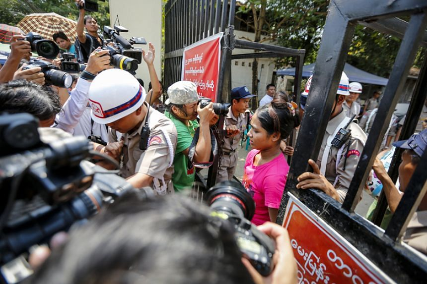 A released prisoner leaves the main entrance of Insein Prison in Yangon on April 17, 2018.