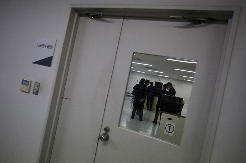 Guards stand inside a processing room at the East Japan Immigration Center in Ushiku, Ibaraki prefecture, on March 19, 2015.