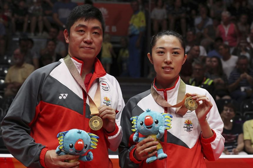 Singapore's table tennis players Gao Ning and Yu Mengyu pose with their Commonwealth Games gold medals in Gold Coast on April 15, 2018.