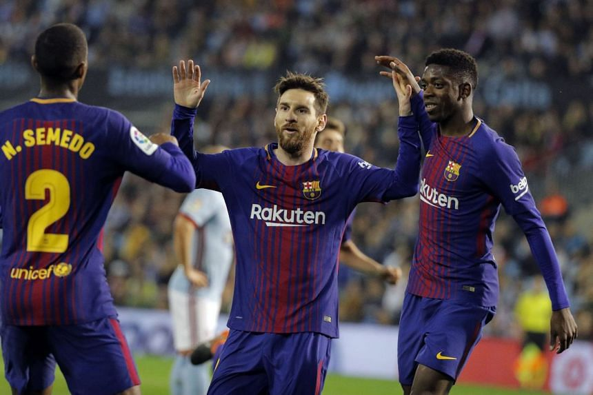 Messi (centre) celebrates with team mates Nelson Semedo (left) and Ousmane Dembele during the match.