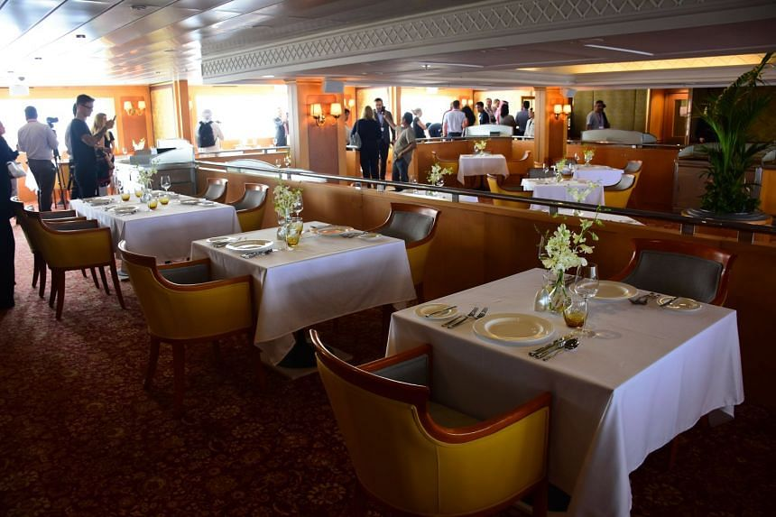 Visitors inspect a restaurant in the legendary Queen Elizabeth II, also known as QE2.