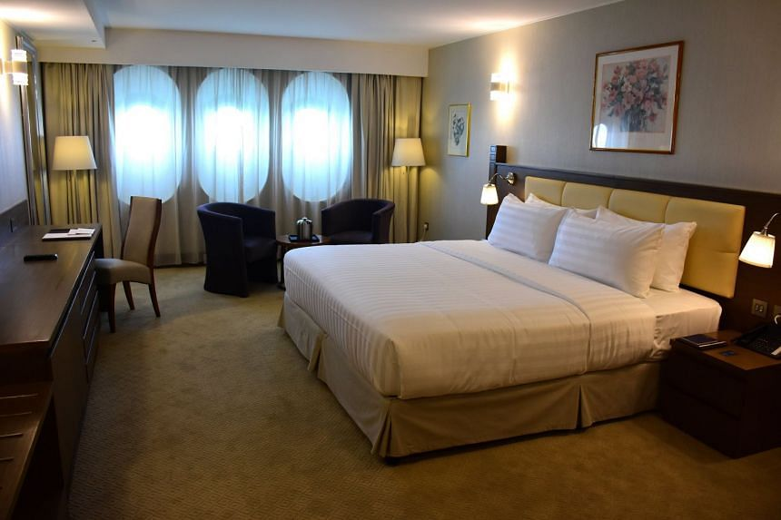 A deluxe room in the legendary Queen Elizabeth II, also known as QE2.