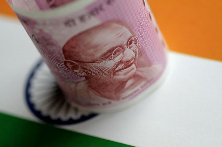 An India Rupee note is seen in this illustration photo.