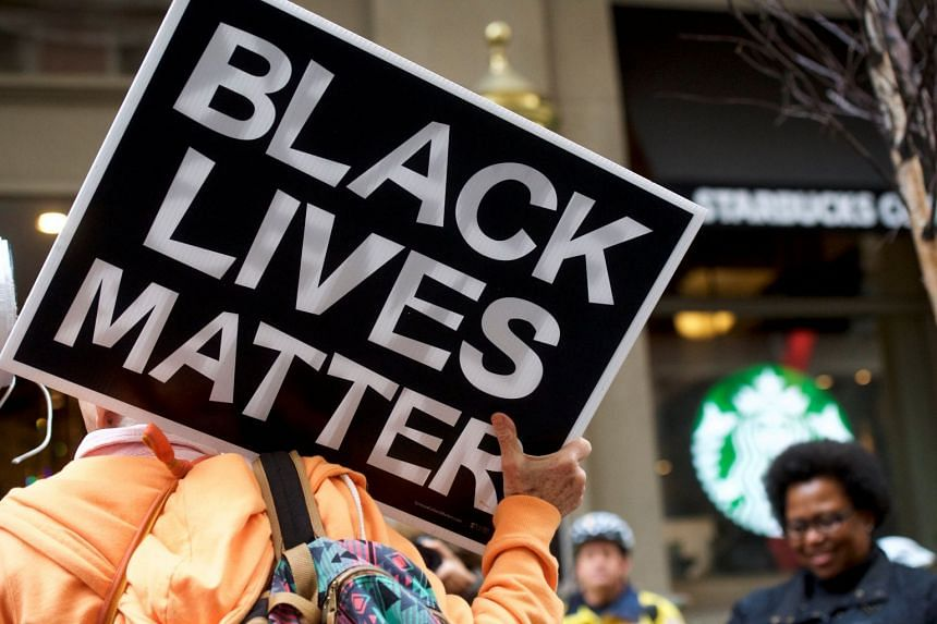 People protesting at Starbucks branches in Philadelphia, Pennsylvania, after the arrest of two black men.