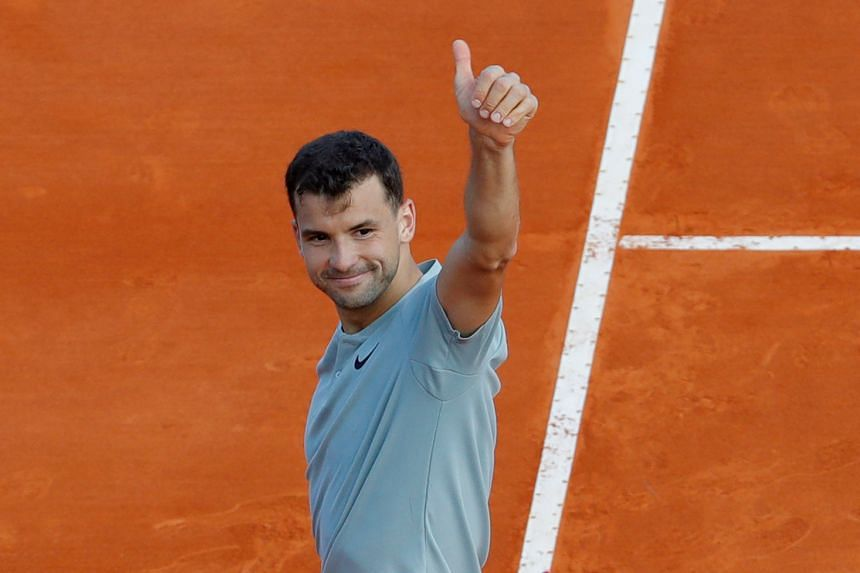 Grigor Dimitrov celebrates winning his second round match against Pierre-Hugues Herbert of France.
