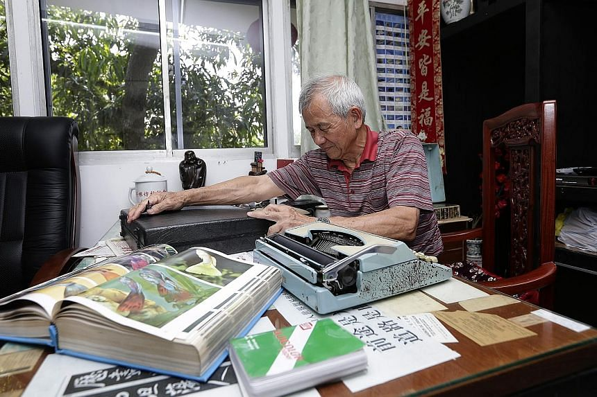 """Mr Pek with a typewriter and """"James Bond"""" Samsonite briefcase he bought 50 years ago. On the hurdles he has faced over the years, he said: """"This is part of doing business. This is what I have learnt as a businessman - there are ups and downs."""""""