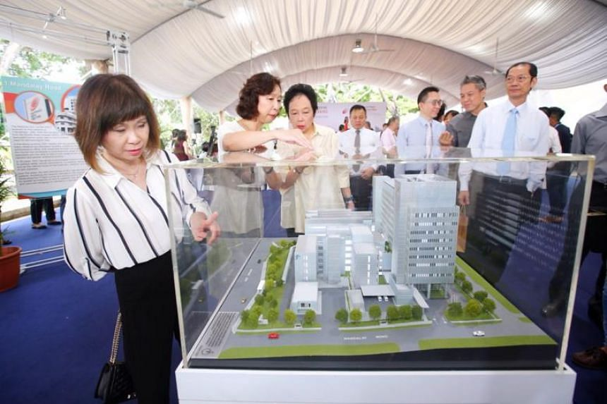 From left: Senior Minister of State for Health, Dr Amy Khor; NSC director, Associate Professor Tan Suat Hoon; and National Healthcare Group chairman, Madam Kay Kuok, looking at a model of the new NSC building at the ground-breaking ceremony on April