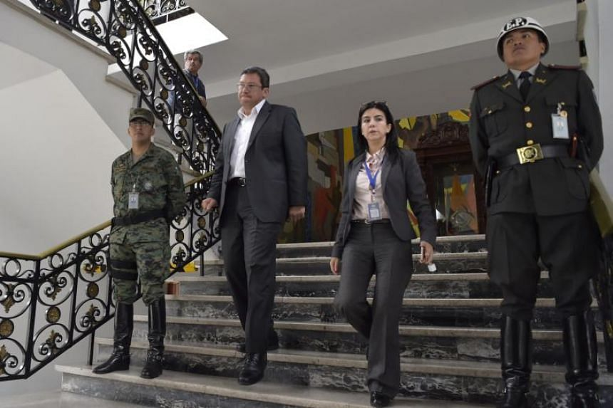 Ecuador's Interior Minister Cesar Navas (second left) arrives to offer a press conference on the recent kidnappings in the Ecuador-Colombia border, at the Carondelet presidential palce in Quito on April 17, 2018.