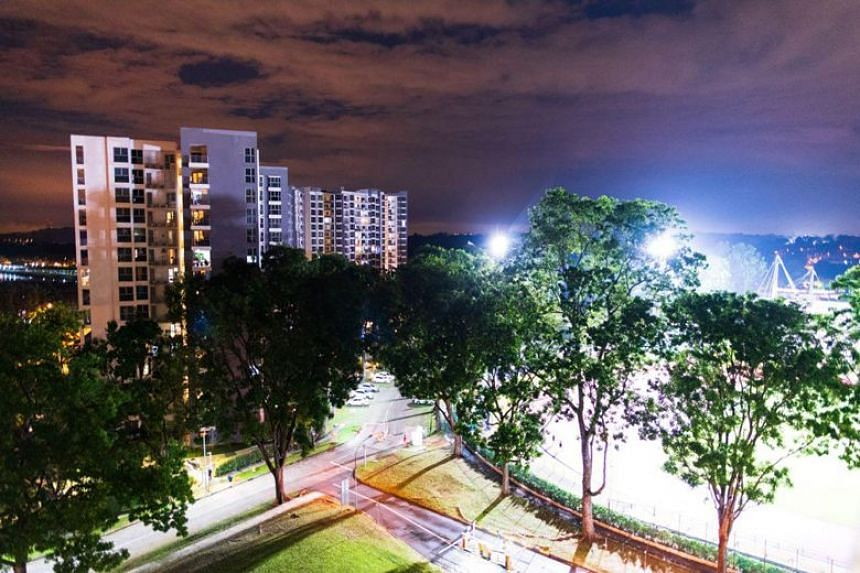 The Estuary condominium (left), which overlooks Yishun Stadium (right). An under-19 football match on April 10, 2018, was abandoned after two of the stadium's four floodlights were turned off at 9pm.