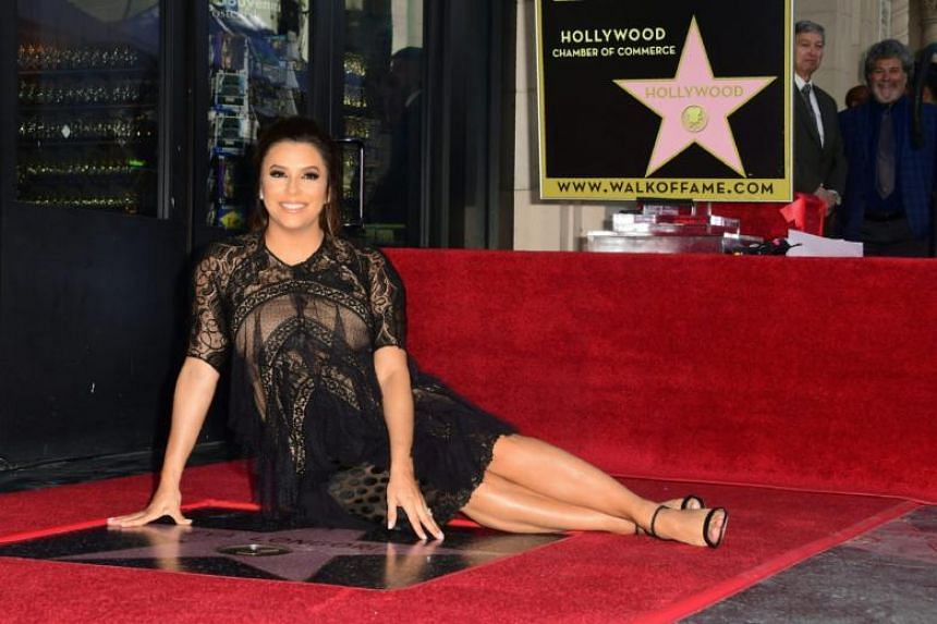 Actress Eva Longoria poses on her Hollywood Walk of Fame Star during a ceremony in Hollywood, California on April 16, 2018.