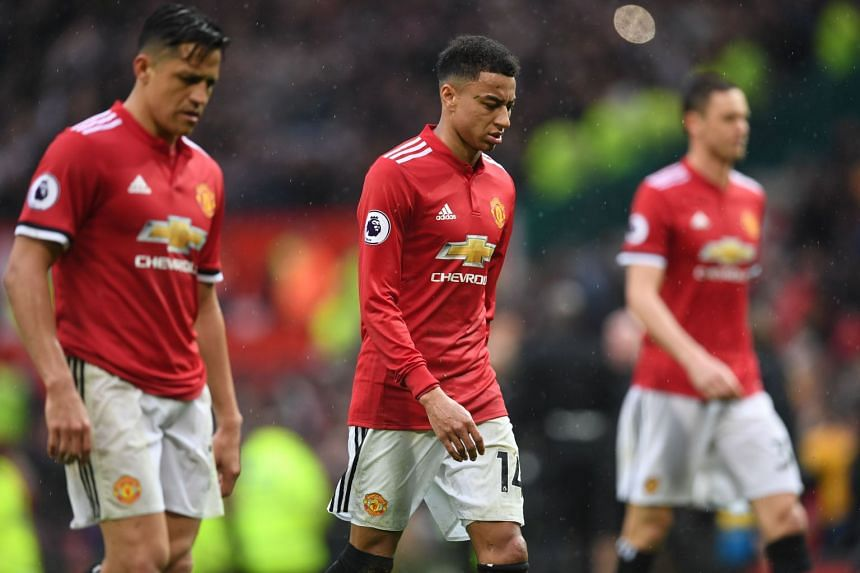 United's Jesse Lingard (centre) walks off after the team's loss to West Brom.