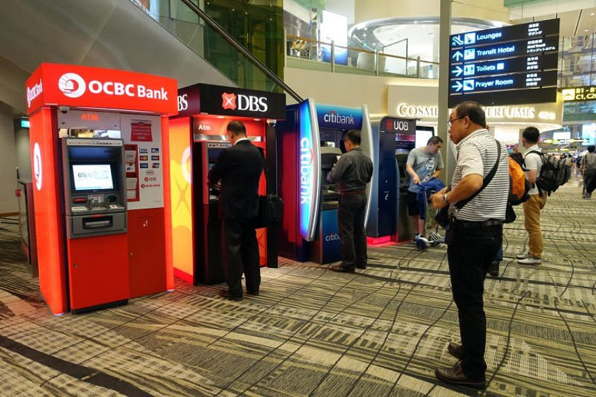 ATMs of OCBC, DBS and other banks located at the passenger departure hall of Changi Airport Terminal 3 in 2016.
