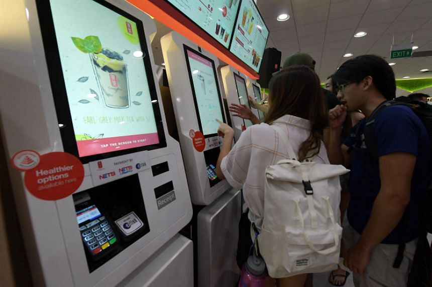 The fully-automated cashless kiosks at the Gong Cha outlet in the National University of Singapore's UTown.