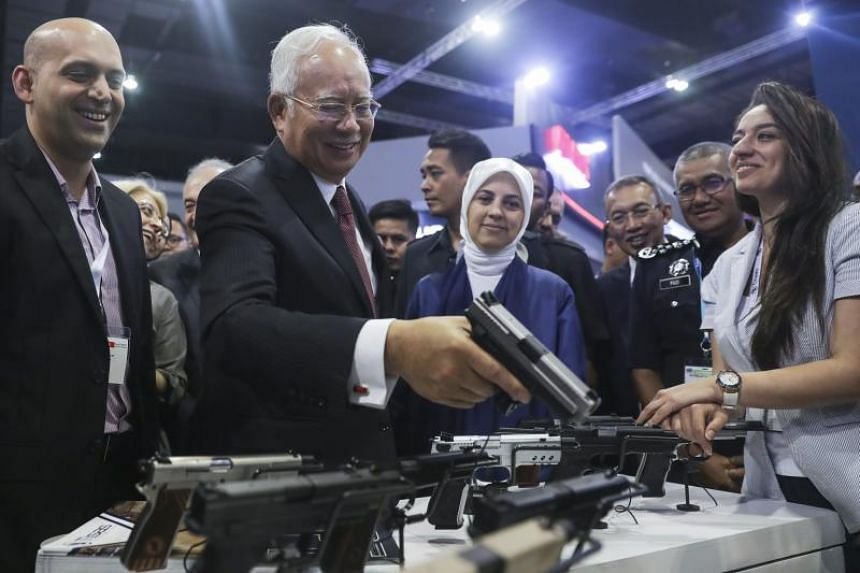Malaysian Prime Minister Najib Razak inspects a Zigana PX-9 pistol during the Defense Services Asia (DSA) 2018 exhibition in Kuala Lumpur, Malaysia, on April 16,  2018.