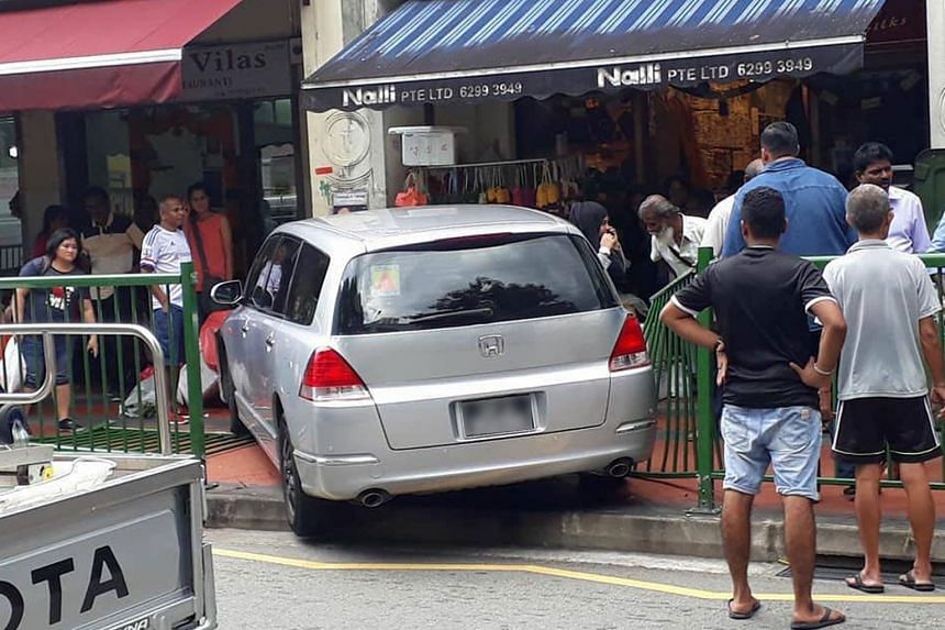 Photos of the accident posted on social media showed that the car rammed through the railing and crashed outside a shophouse.