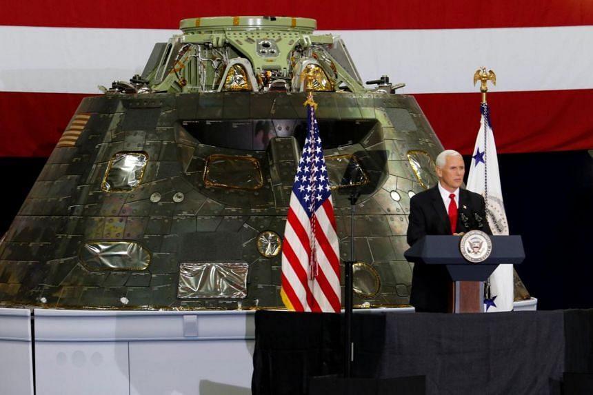 US Vice-President Mike Pence visiting the Kennedy Space Center, Florida July 6, 2017. Seen behind him is the Orion Capsule that will be launched at a future date.