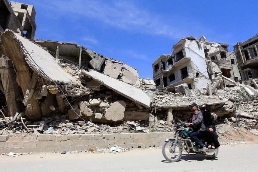 Damaged buildings are seen in Douma on the outskirts of Damascus, on April 16, 2018.
