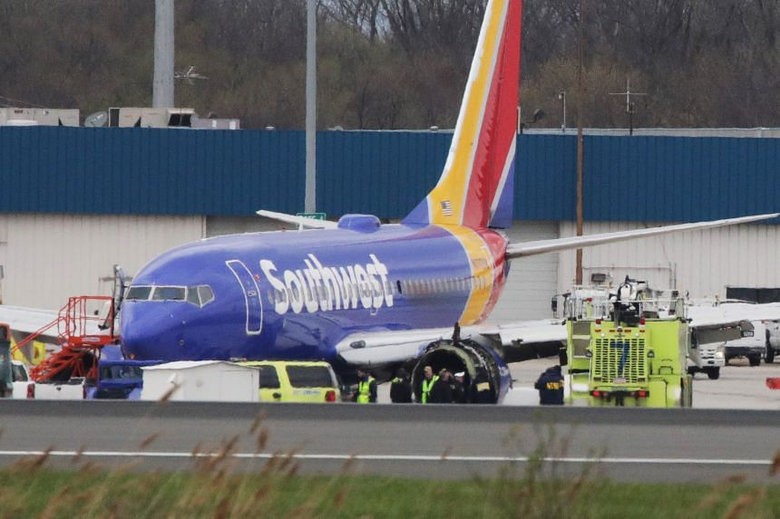 The Southwest Airlines jet sitting on the runway at Philadelphia International Airport after it was forced to land with an engine failure, on April 17, 2018.