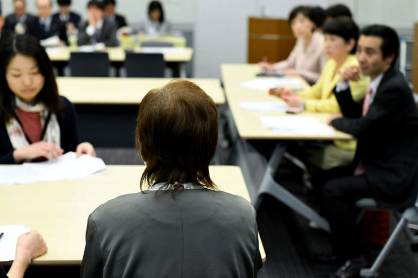 Ms Junko Iizuka (centre), who was sterilised at the age for 16, delivering her message during a meeting with lawmakers in Tokyo, on March 29, 2018.